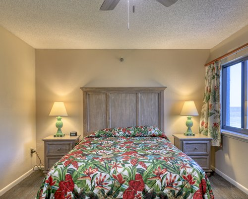 A bathroom with double sink vanity enclosed toilet.