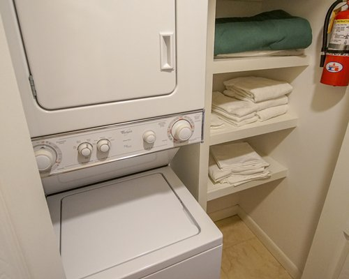 An indoor laundry area with a washing machine & dryer.