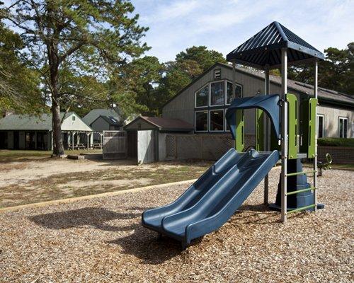 An outdoor play area alongside resort.
