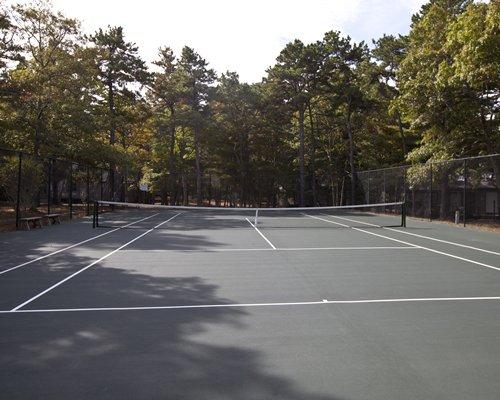 An outdoor tennis court.
