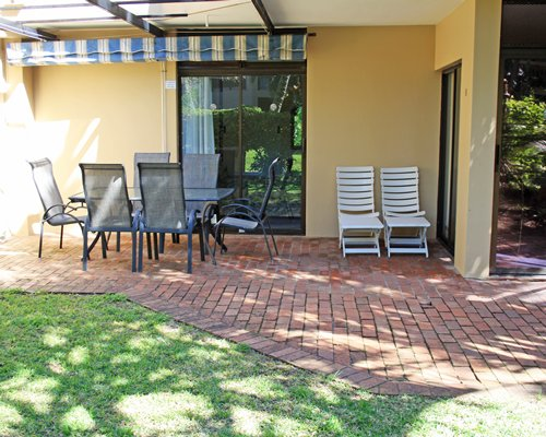 Exterior view of La Lucia Sands resort with patio furniture.