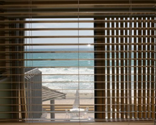 A view of the beach from a resort unit window.
