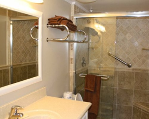 A bathroom with shower and sink vanity.