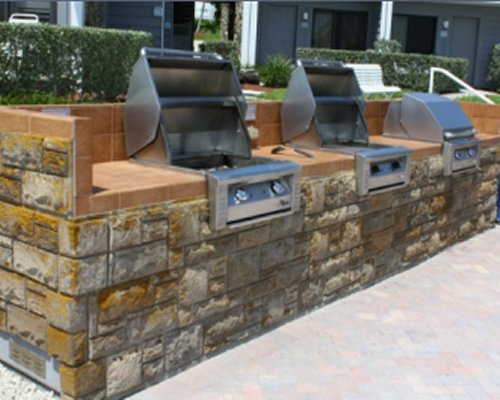 An outdoor area with multiple barbecue grills.