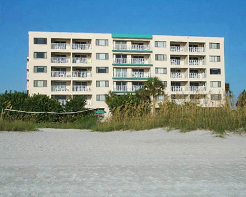 Scenic exterior view of Sand Pebble Resort with multiple balconies.