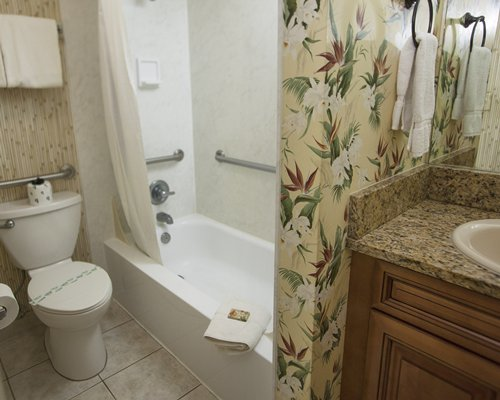A bathroom with bath tub and shower.