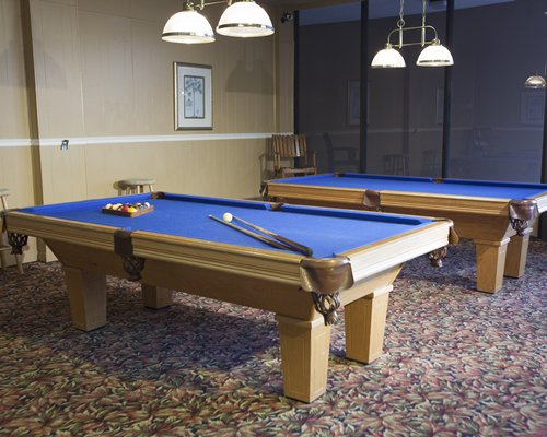 An indoor play area with two pool tables.
