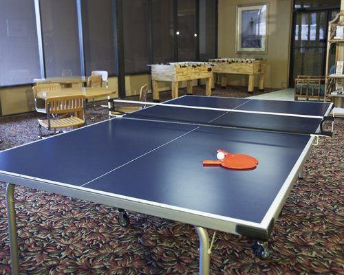 An indoor play area with table tennis.