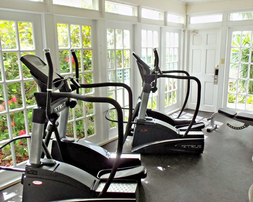 An indoor fitness area with outside view.