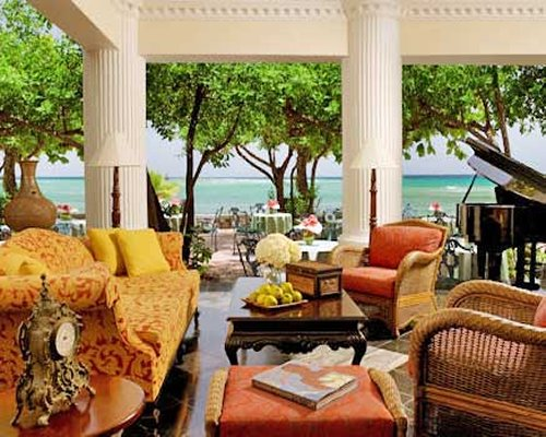 A well furnished lounge area with a view of the ocean.