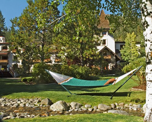 Scenic view of Olympic Village Inn resort with hammock.