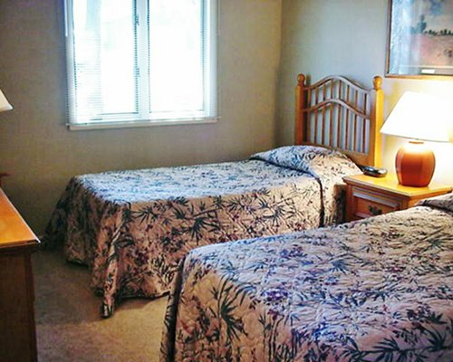 Furnished bedroom with two beds.