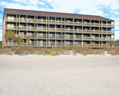 Exterior view of Windy Shores with multiple unit balconies.