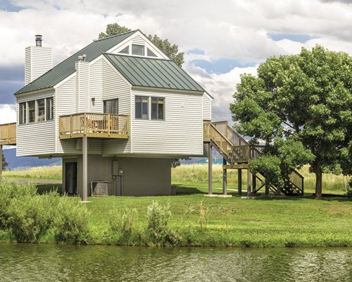 Exterior view of a unit with a waterfront at Wyndham Pagosa.