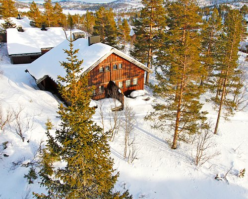 Exterior view of Hallbjonn Telemark covered by snow.