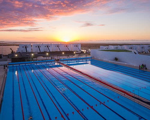 An outdoor swimming pool at dusk.