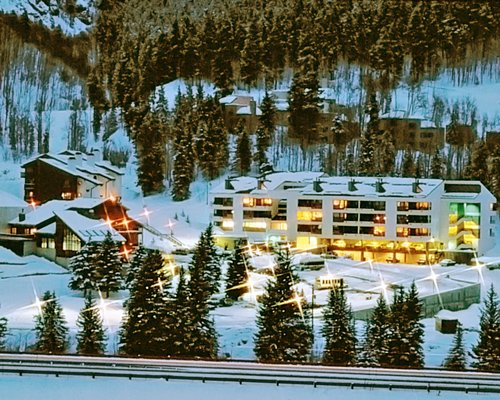 Exterior view of Streamside At Vail Douglas surrounded by wooded area during winter.