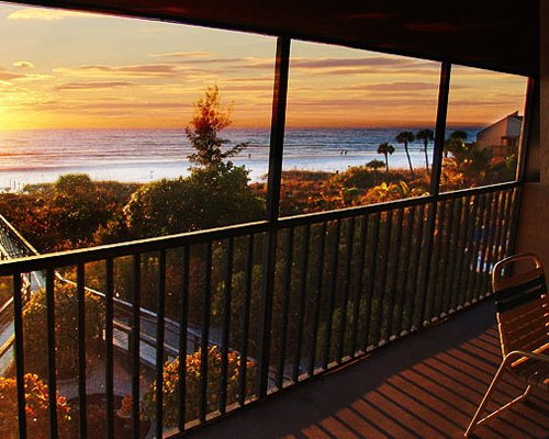 Balcony view of the ocean at sunrise.