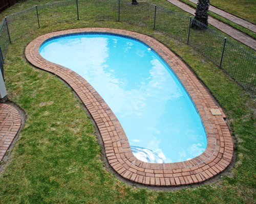 A scenic outdoor swimming pool.