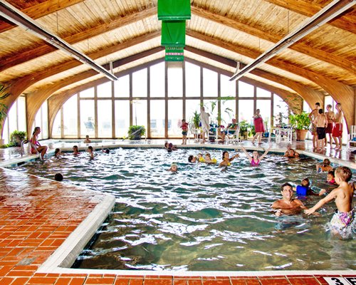 View of people at an indoor swimming pool.