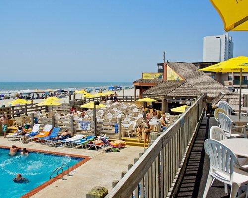 Balcony view of resort properties alongside the ocean.