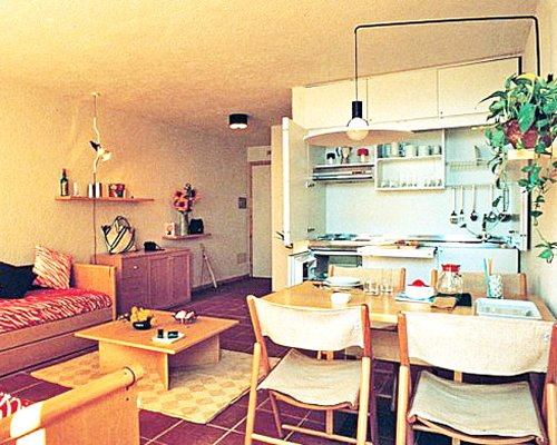 A well furnished open plan living dining and kitchen area.