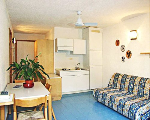 A well furnished open plan living dining and kitchen area with a telephone.