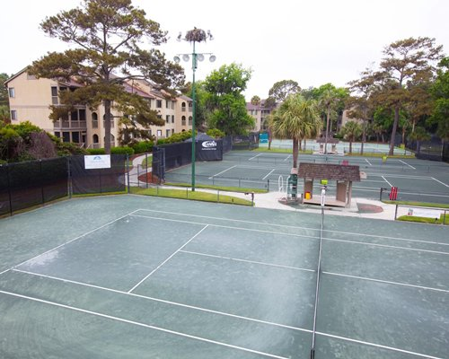 Outdoor recreation area with tennis courts.
