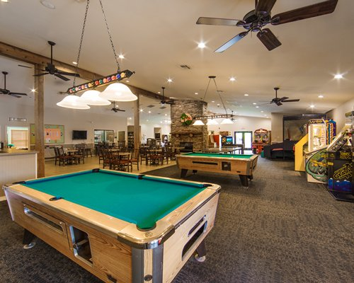 A large game room with pool tables.