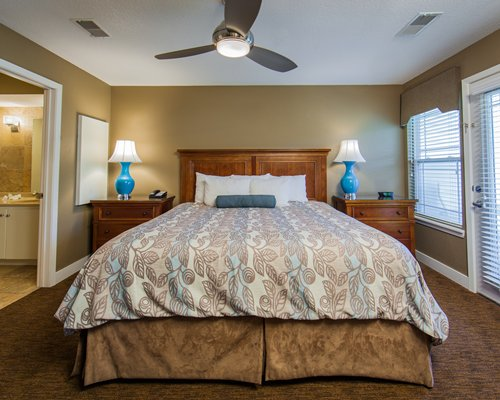 A well furnished bedroom with a large bed.