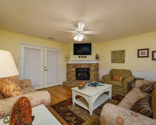 A view of living room with a television and fireplace.