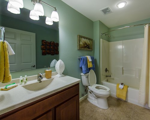 A bathroom with a shower stall and a sink vanity.