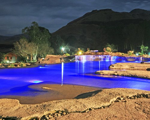 A view of outdoor swimming pool at night.