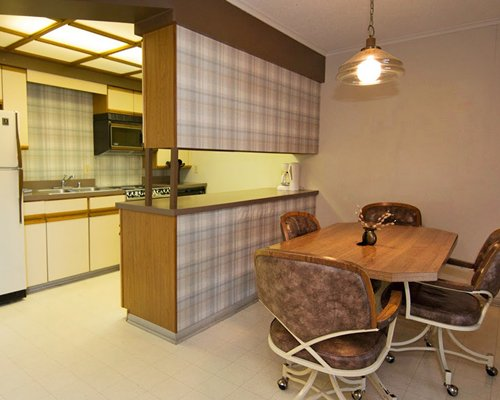 A well equipped kitchen with dining area.