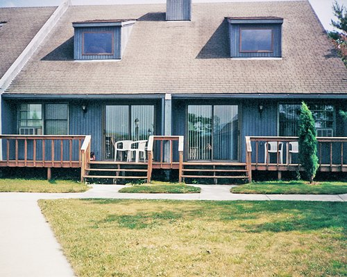 Exterior view of units at Land Of Canaan Vacation Resort with an outdoor patio.