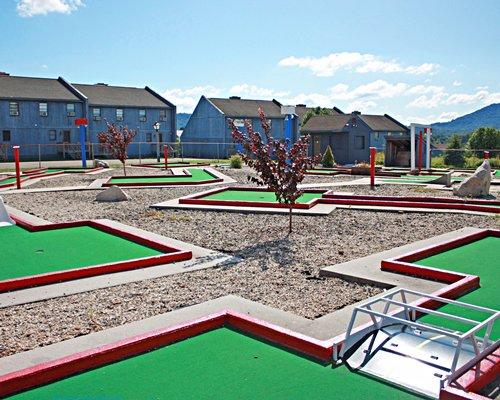 Land Of Canaan Vacation Resort Inc. with outdoor putt putt golf course.