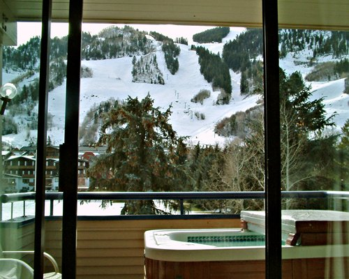 A hot tub alongside a snow covered area.
