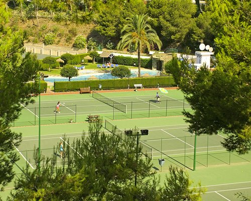 Scenic view of outdoor tennis courts.