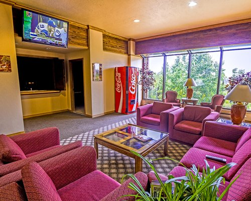 A well furnished living room with a television and an outside view.