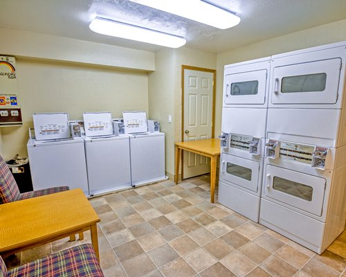 Laundry room at Copper Chase Condominiums.