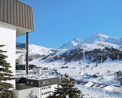 An exterior view of the Palace Residence I alongside the snowy mountain.