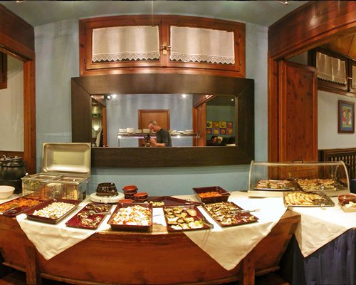 An indoor buffet area with various dishes.
