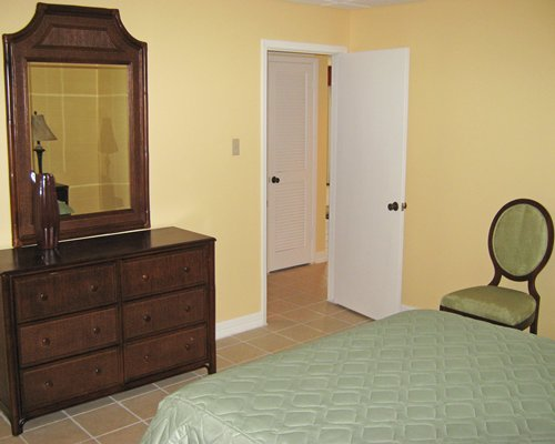 A well furnished bedroom with a vanity.