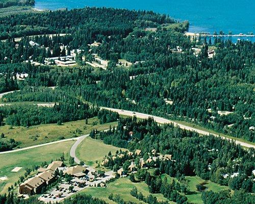 Birds eye view of Elkhorn Resort alongside the ocean.