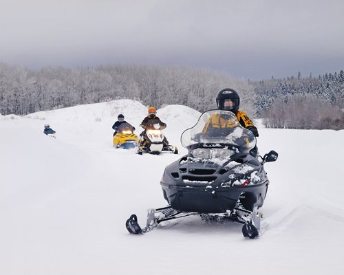 A view of people snowmobiling.