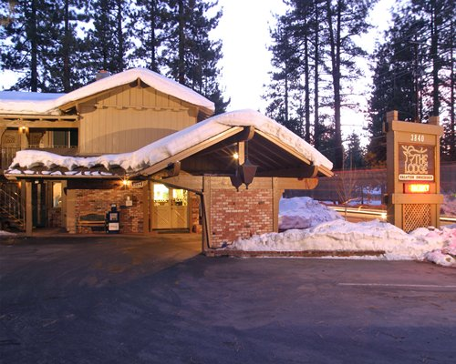 An exterior view of The Lodge at Lake Tahoe surrounded by wooded area.