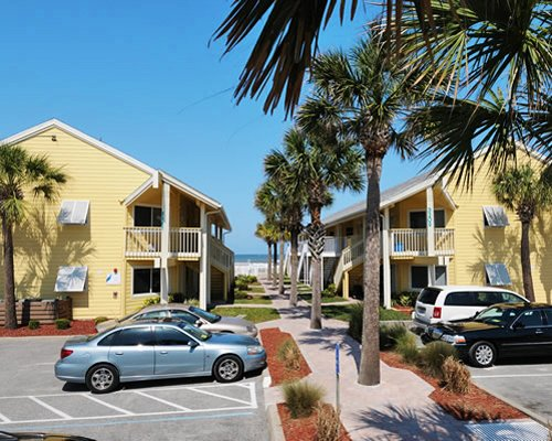 Scenic exterior view of multiple unit balconies with a parking lot.