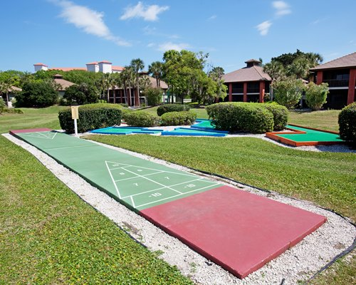 An outdoor shuffleboard and golf miniatures.