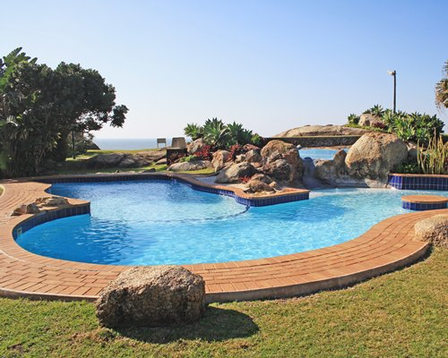 A large landscaped outdoor swimming pool.