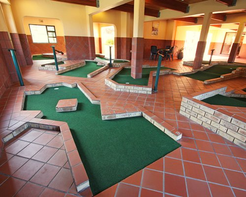 Indoor recreation room with putt putt golf course.